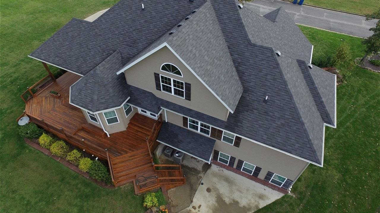 birds eye view of large home with beautiful gazebo and deck