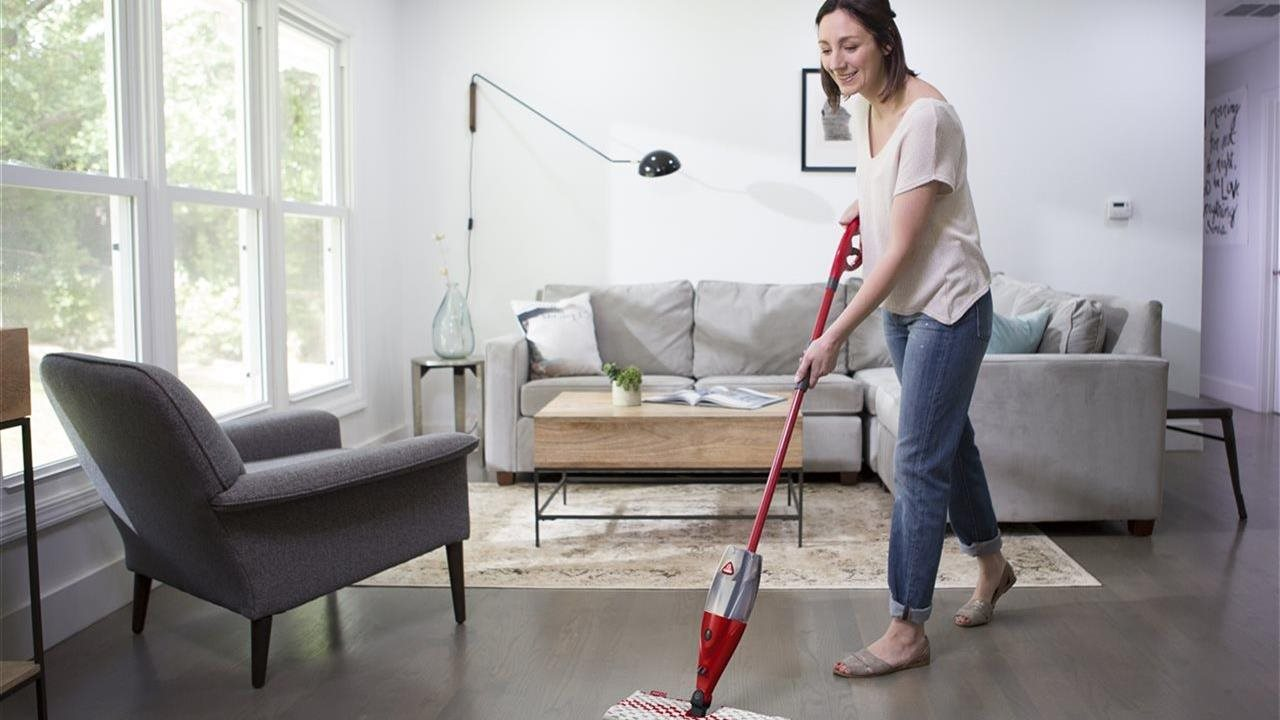 woman cleaning floor in the living room