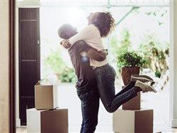 happy couple moving in to their new house