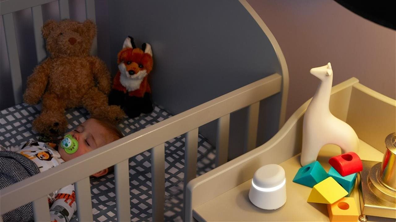 baby in crib with first alert on night stand