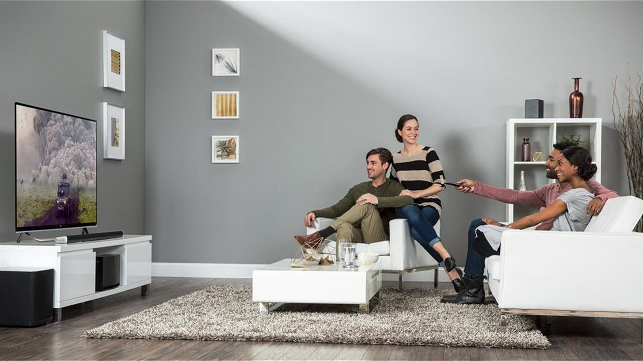 two couples watching tv together in a livingroom