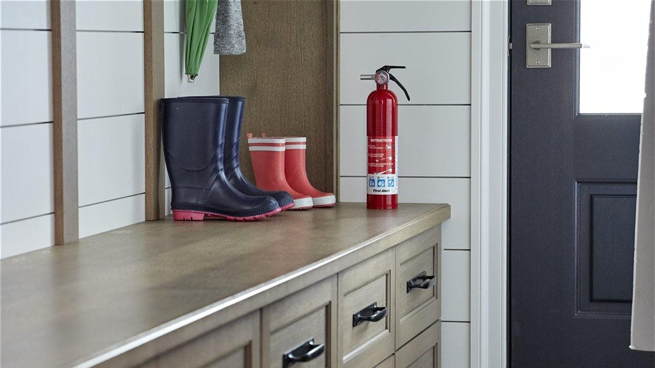 Close-up of fire extinguisher in mud room