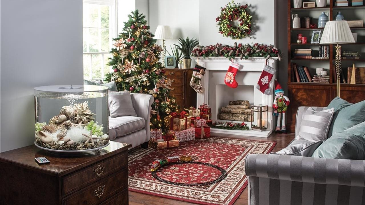 living room with fireplace Christmas tree and gifts