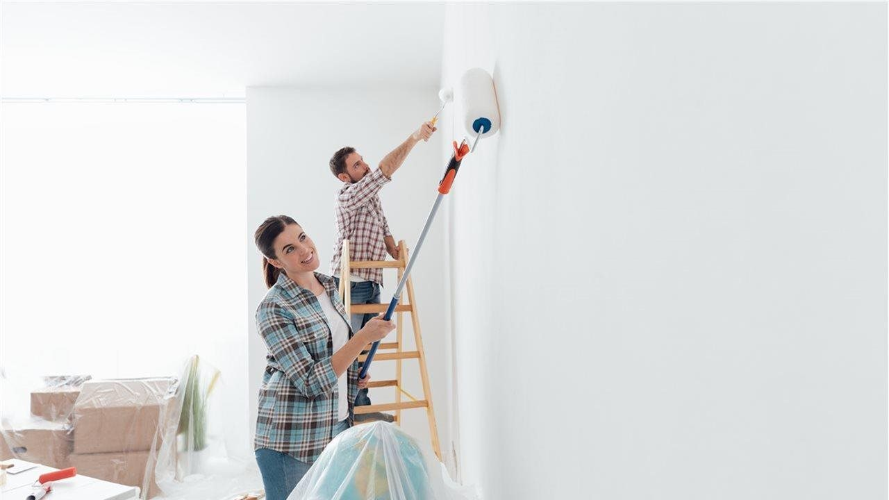 couple painting the living room