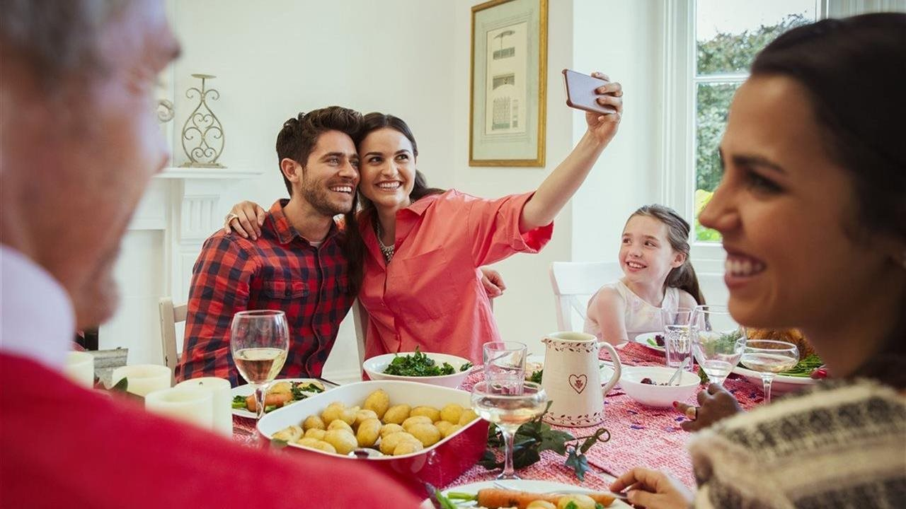 couple at holiday party taking selfie