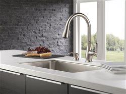 Delta faucet in the sink of an upscale kitchen