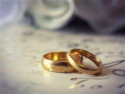 two wedding rings leaning against each other on lovely wedding wrapping paper