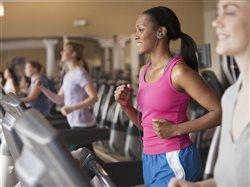 women in a gym on treadmills