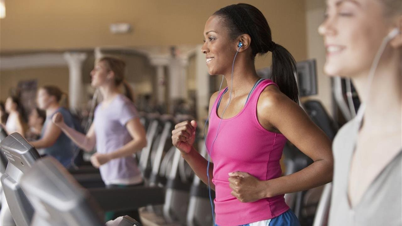 women in a gym on treadmills