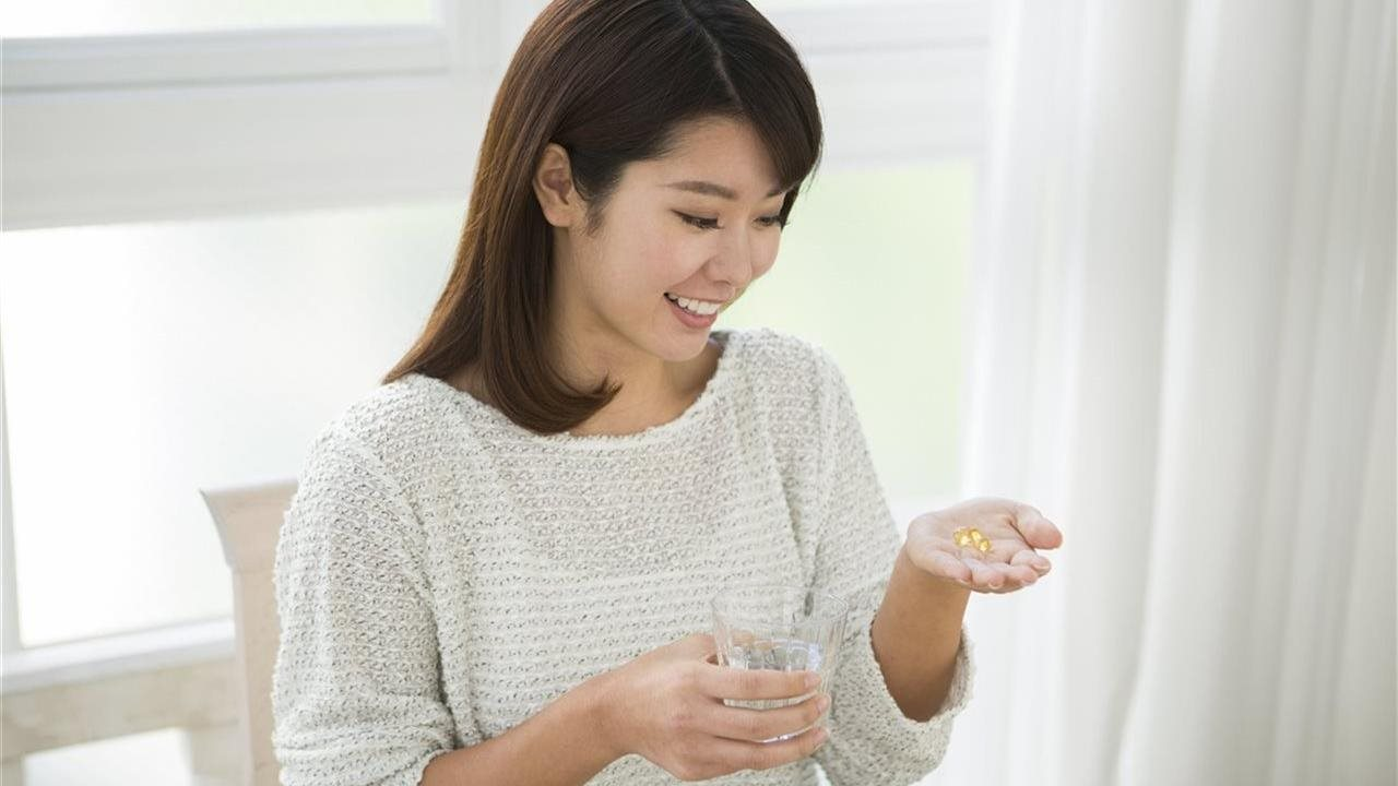 Woman taking vitamins