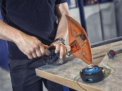 man working with power tool at work bench