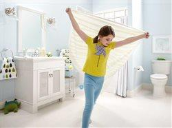 little girl flying around the bath with a towel
