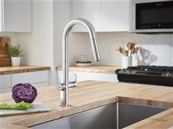sleek modern faucet with sink set in bucher block