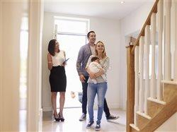 Family looking at new house with a realtor