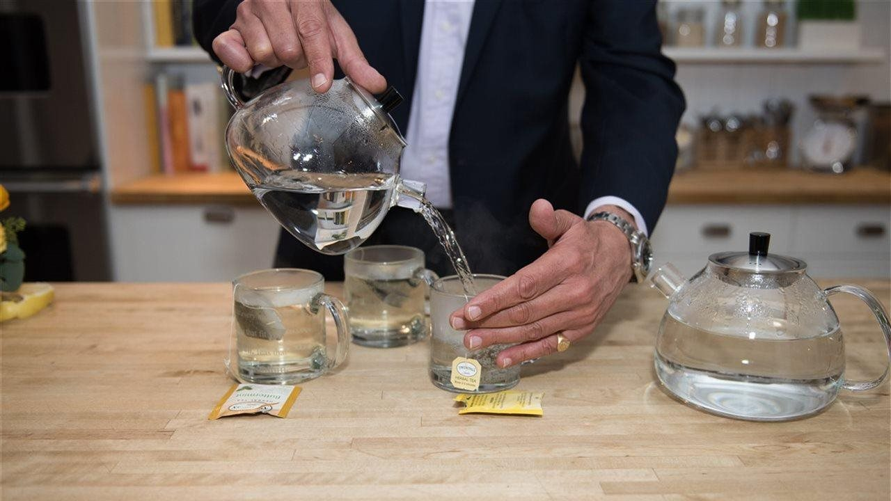 man pouring the perfect cup of tea