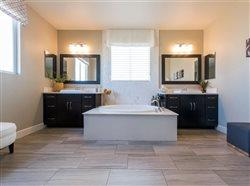 finished tile in an upscale bath with tub and double vanity