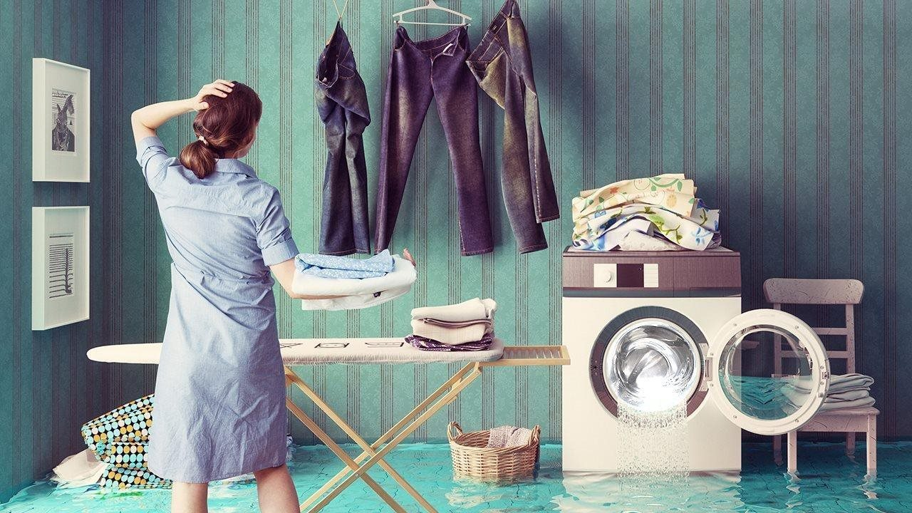 woman in flooded laundry room doing laundry