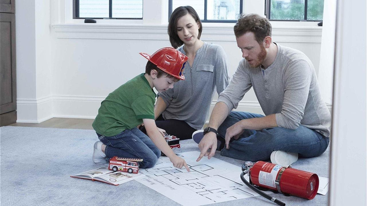 Mom dad and son looking at map of home emergency route