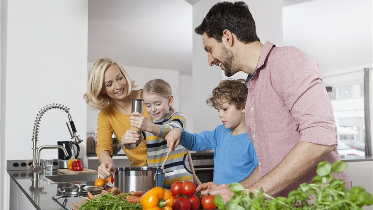 family of four making healthy dinner
