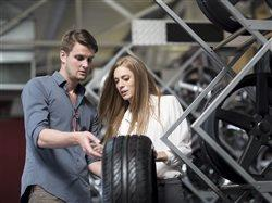couple looking at care tires