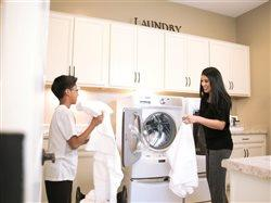 Mom and son doing laundry in the laundryroom