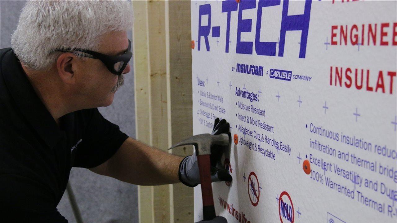 man installing foam insulation
