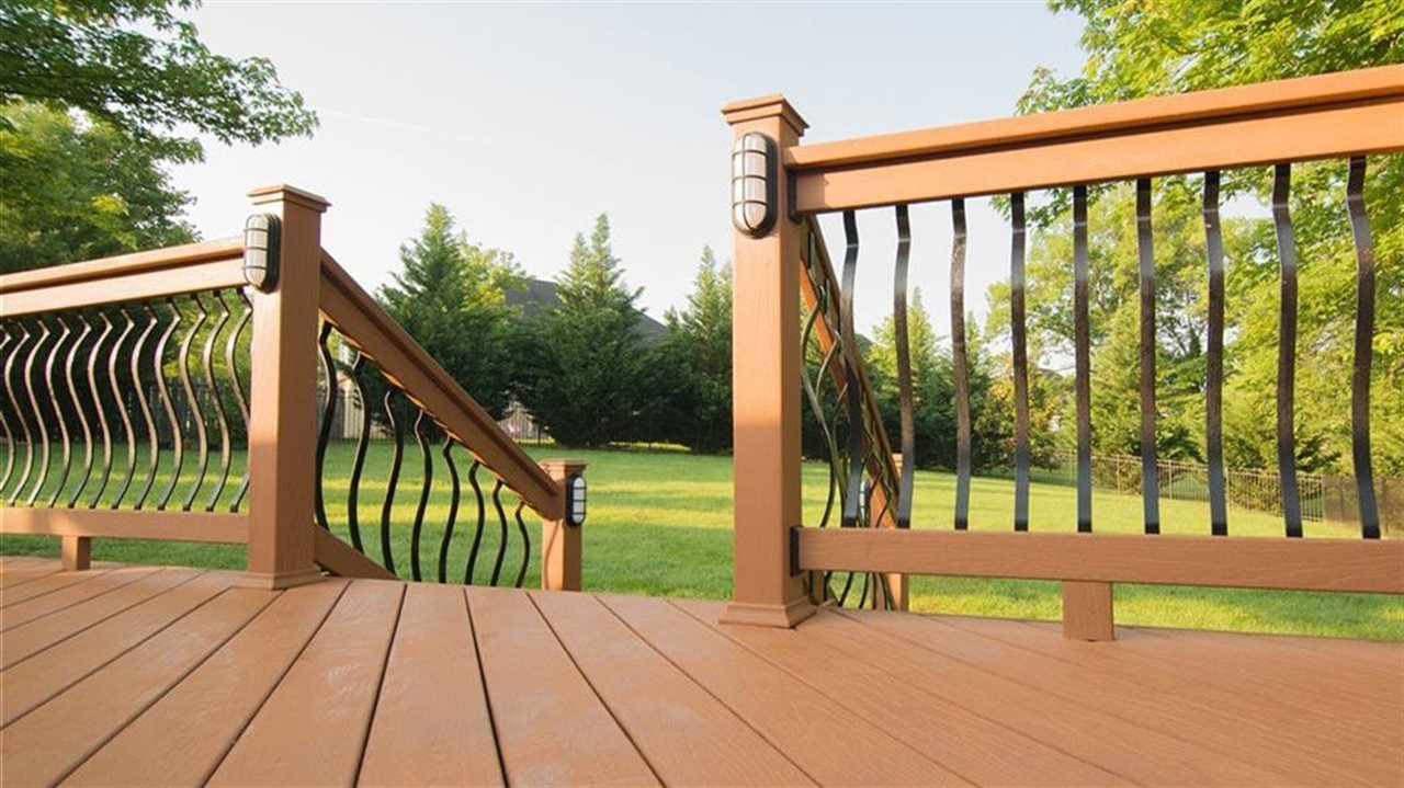 Deck with rail in late afternoon lighting.