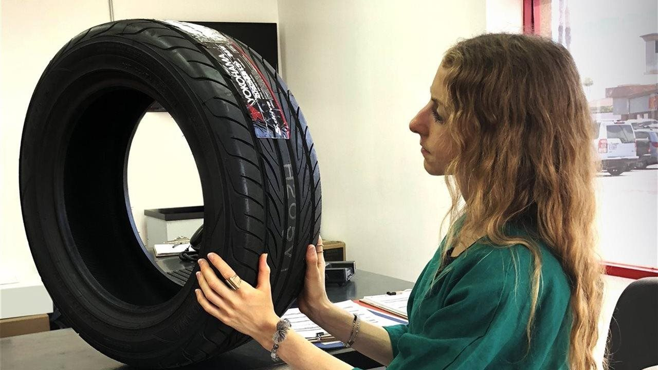 woman looking at tire in store