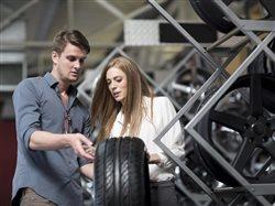 couple selecting a tire