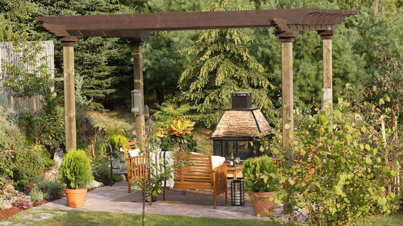 pergola over fire place and patio in backyard