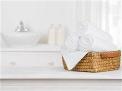 bath towels in a basket in a bathroom