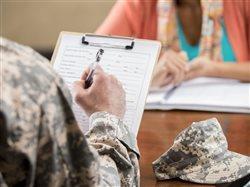 veteran applying for a job sitting across form an HR person