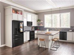 LG matte black kitchen appliances in upscale home