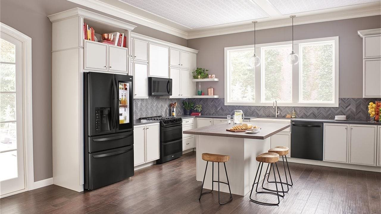 LG matte black kitchen appliances in upscale home