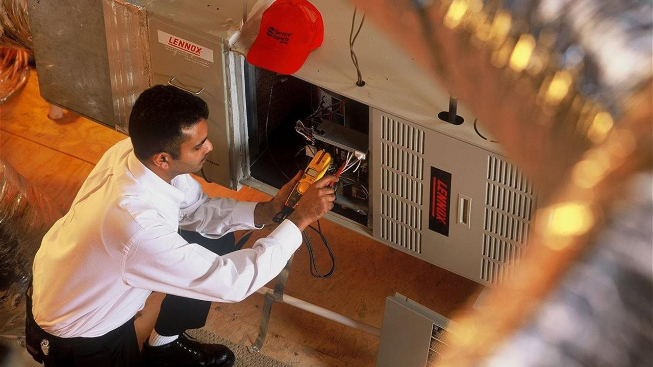 HVAC person working on the heat
