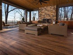 beautiful exterior porch with firplace and open areas to outside deck.
