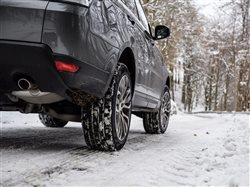 close-up of back end of vehicle driving on snow covered roads