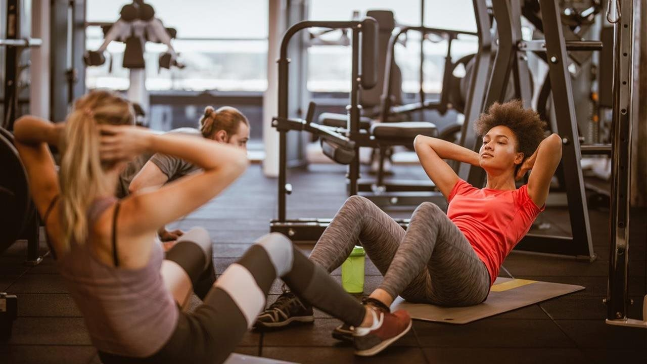 3 people working out in a gym