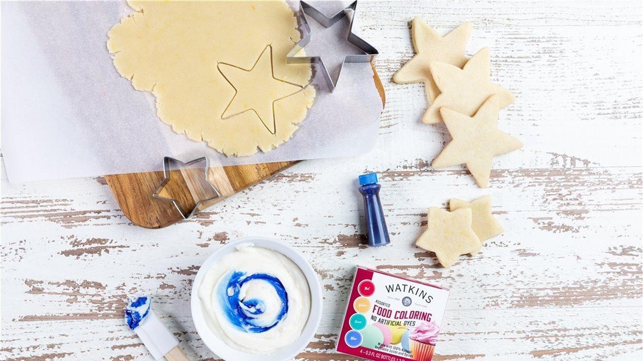 Watkins food coloring and starcookies cut out of sugar dough
