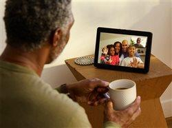 man talking with family members over internet