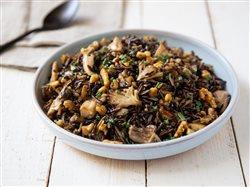 Maitake Wild Rice Salad in a bolw on a white table