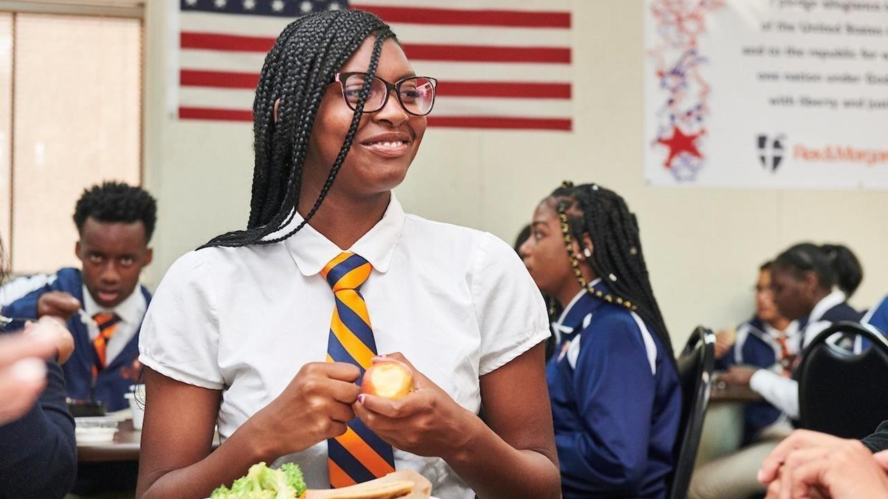 teen eating healthy foods at school